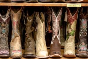 men's women's kids and toddlers cowboy boots lined up